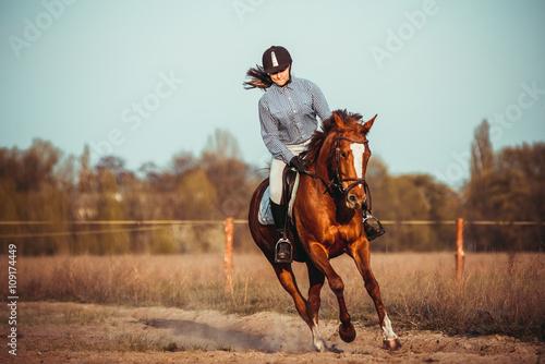 Girl riding a horse Poster Mural XXL