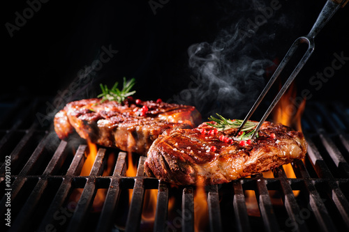 Beef steaks on the grill