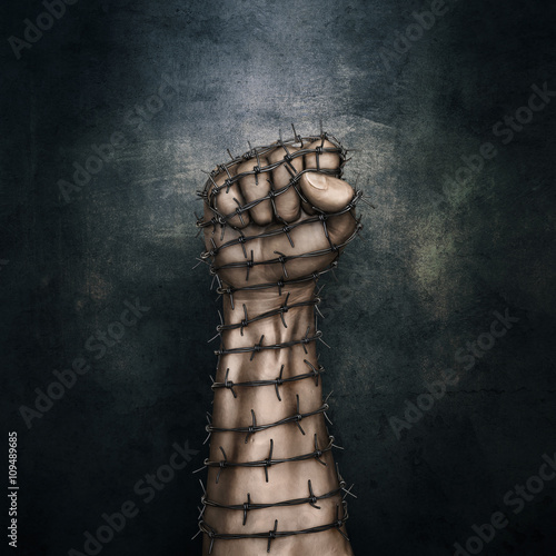Photo Barbed wire fist / 3D illustration of grungy raised fist wrapped in barbed wire