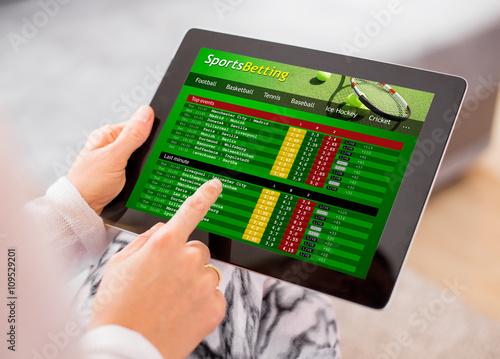 Slika na platnu Sports betting app on ipad