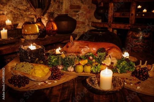 Fototapeta Medieval ancient kitchen table with typical food in royal castle.
