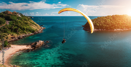 Skydiver flying over the water