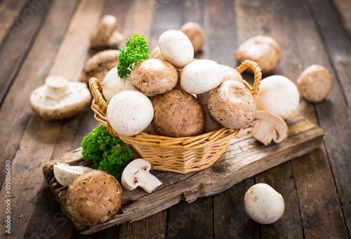 Obraz na płótnie Champignon mushroom on the wooden table