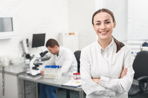 Fotografiet Cheerful female researcher is evincing positive emotions
