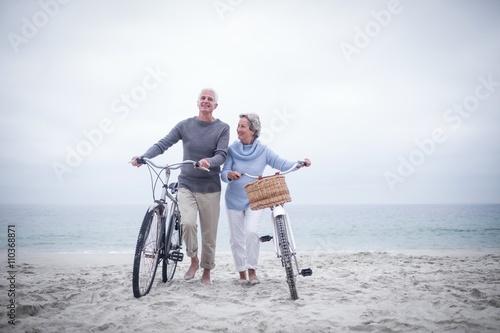 Senior couple having ride with their bike