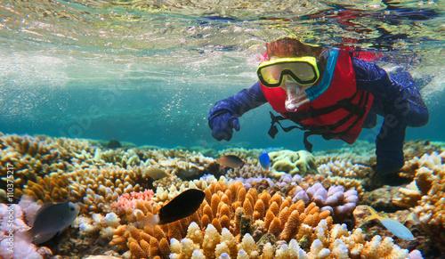 Photo Child snorkeling in Great Barrier Reef Queensland Australia