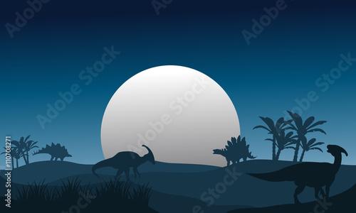 фотография Silhouette of stegosaurus and parasaurolophus