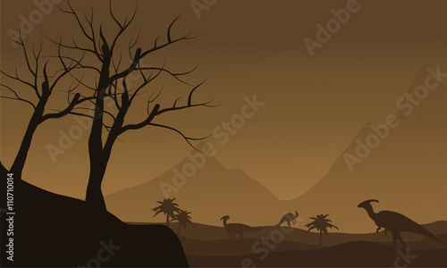 фотография Silhouette of many dinosaur in fields