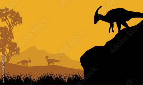 Платно At the morning parasaurolophus silhouette in hills
