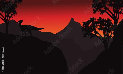 фотография At sunset silhouette parasaurolophus in cliff
