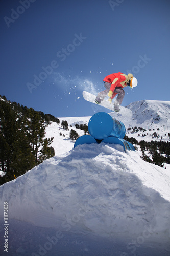 Canvas Print Snowboard rider jumping on winter mountains