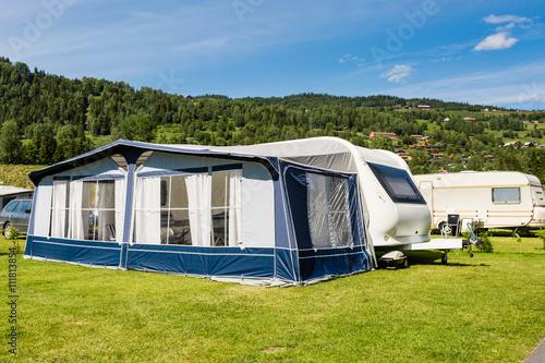 Modern caravan at camping site Fototapeta