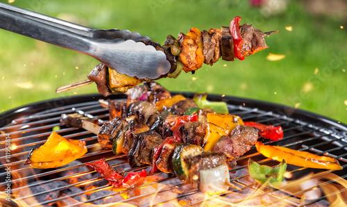 Meat skewer on grill