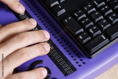 Blind person using computer with braille computer display Fototapet