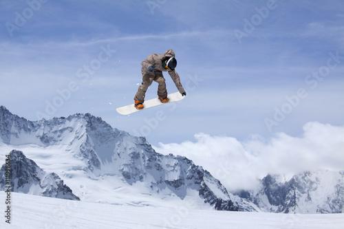 Wallpaper Mural Snowboard rider jumping on mountains