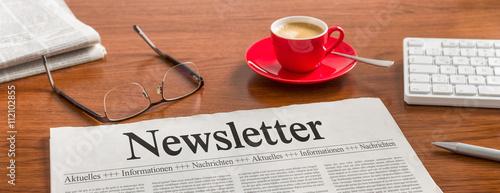 Photo Zeitung auf Schreibtisch - Newsletter