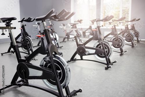 Obraz na plátně Healthy lifestyle concept. Spinning class with empty bikes