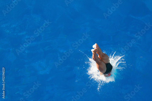 Tablou Canvas Splash. Diver entering the water. Shot from above