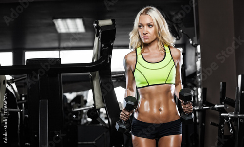 Tablou Canvas young fitness woman execute exercise