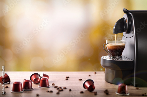 Espresso machine making coffee on wood table front view Fototapet