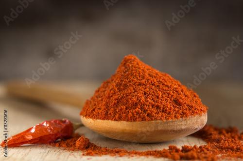 Slika na platnu Spoon filled with red hot paprika powder