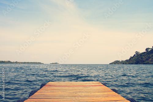 Murais de parede Dock on beautiful blue lake