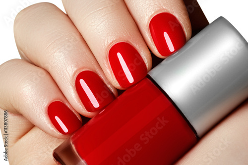 Photo Manicure. Beautiful manicured woman's hands with red nail polish