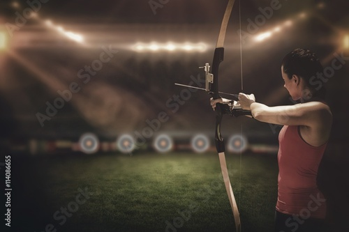 Leinwand Poster Side view of woman practicing archery