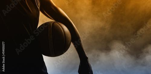 Closeup of a man holding a basketball
