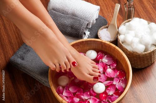 Beautiful female feet at spa salon on pedicure procedure.