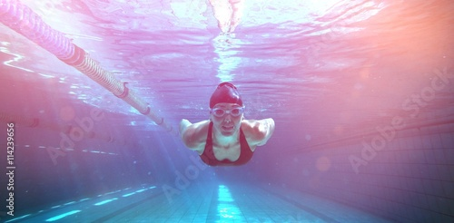 Canvas Print Athletic swimmer training on her own