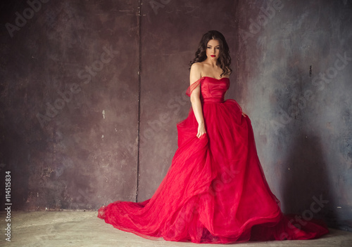 Valokuvatapetti portrait of sensual woman in a long gorgeous red dress
