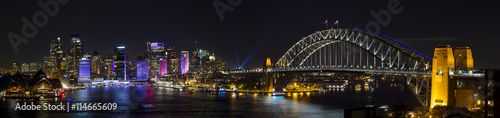 Sydney Harbour during Vivid Light Festival / Panorama of Sydney Skyline and harbour. including harbour bridge and Opera House.