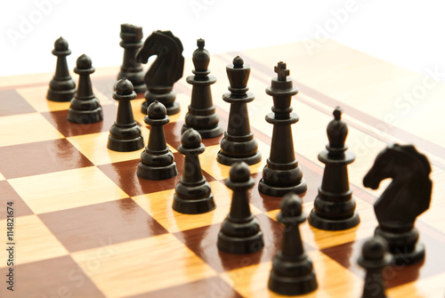 Fototapeta černé šachové figurky na šachovnici