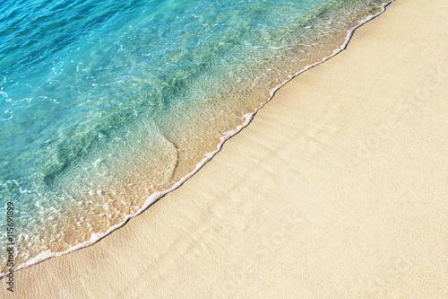 Wallpaper Mural Soft ocean wave on the sandy beach, background.