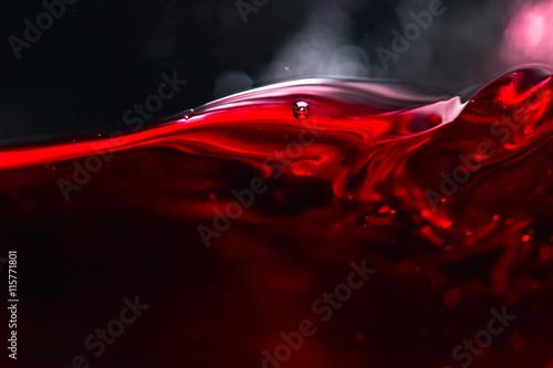 Red wine on black background