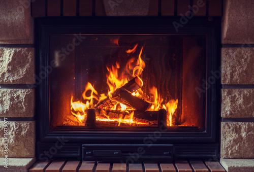 Carta da parati close up of burning fireplace at home