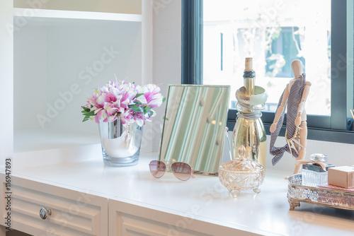 Valokuvatapetti women's accesories on dressing white table