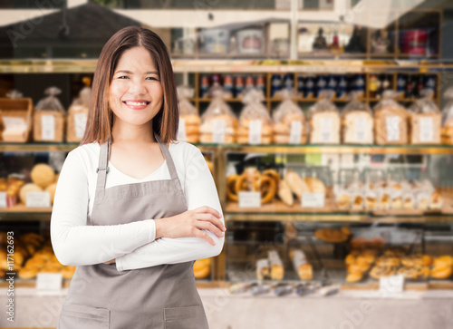 Carta da parati business owner with bakery shop background