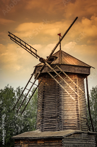old wooden windmill on a sunset background