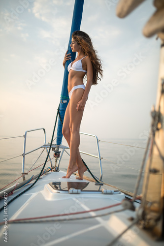 Girl stands on the yacht