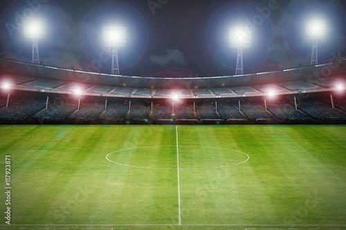 Fototapeta premium 3d rendering pusty stadion z boiskiem do piłki nożnej