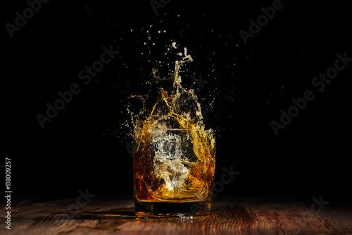 cognac on the wooden table Fototapeta