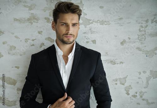 Valokuva Portrait of sexy man in black suit