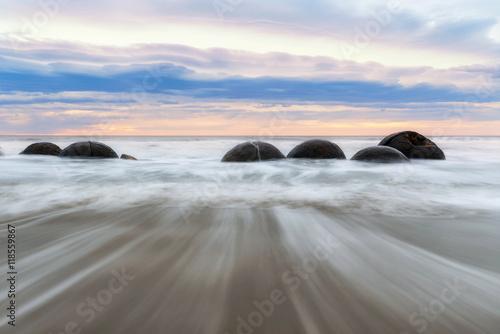 Stampa su Tela Moeraki Boulders at sunset. New Zealand