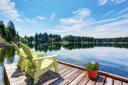 Wallpaper Mural Perfect water view pier. Waterfront lake with small pier.