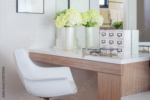 Fotografie, Obraz Jewelry accessory and jar of flower on white top dressing table