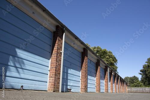 Fotografie, Obraz Sunny Blue Garages
