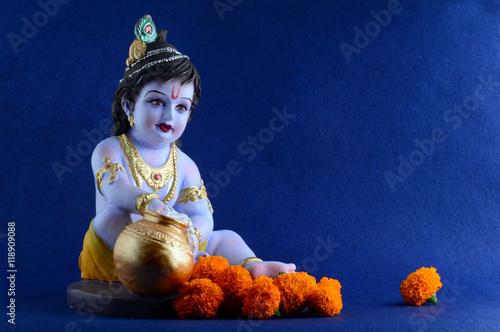 Hindu God Krishna on blue background