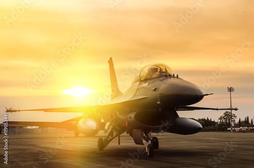Fotografie, Obraz f16 falcon fighter jet parked  on sunset  background